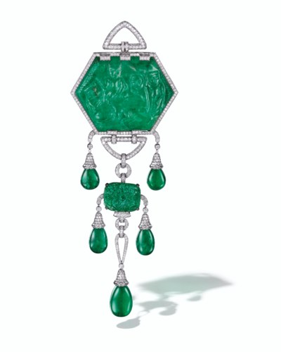 A CARVED EMERALD WITH TWO INTE