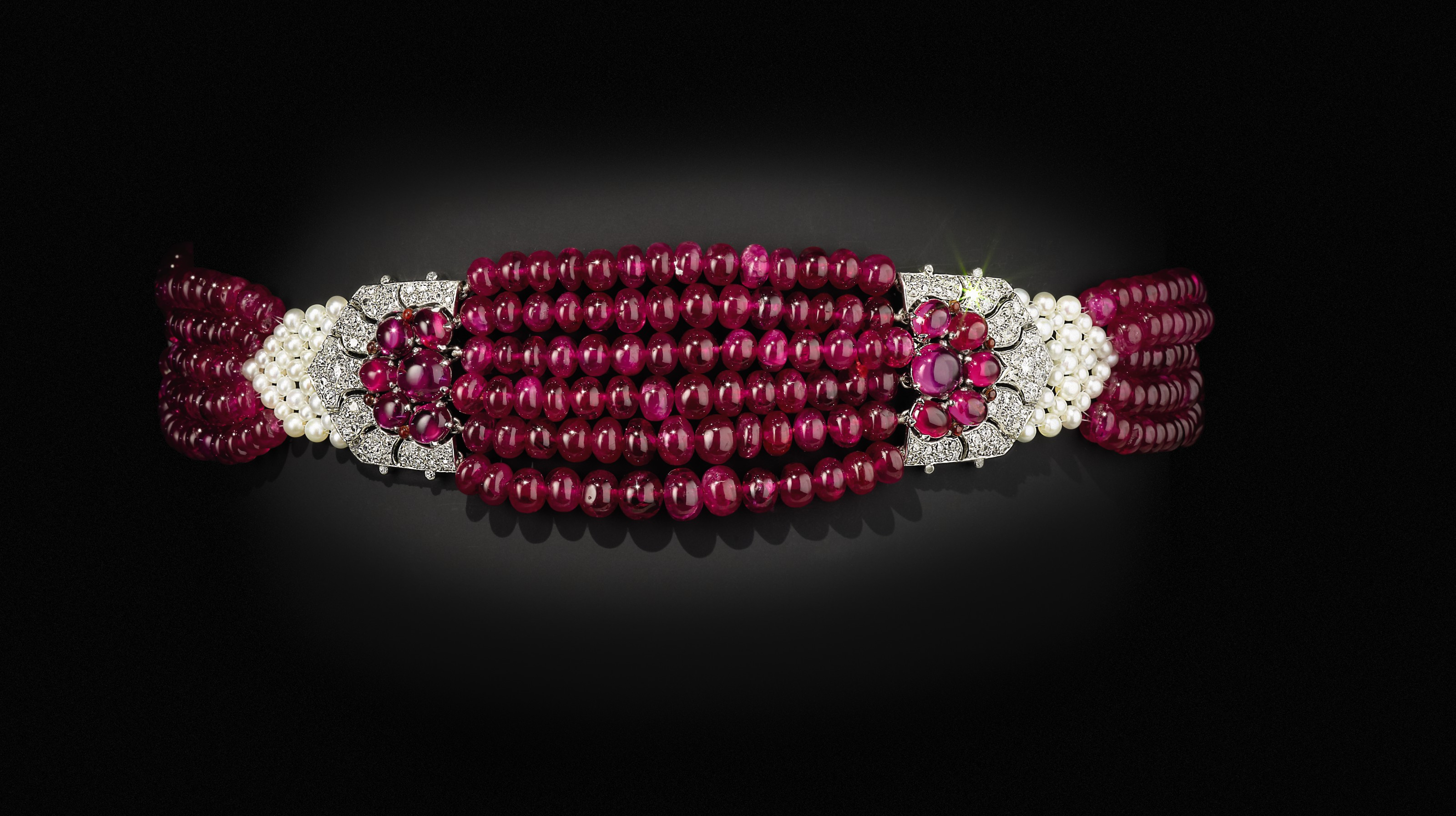 'THE PATIALA RUBY CHOKER' AN ART DECO RUBY, DIAMOND AND NATURAL PEARL CHOKER NECKLACE, CARTIER