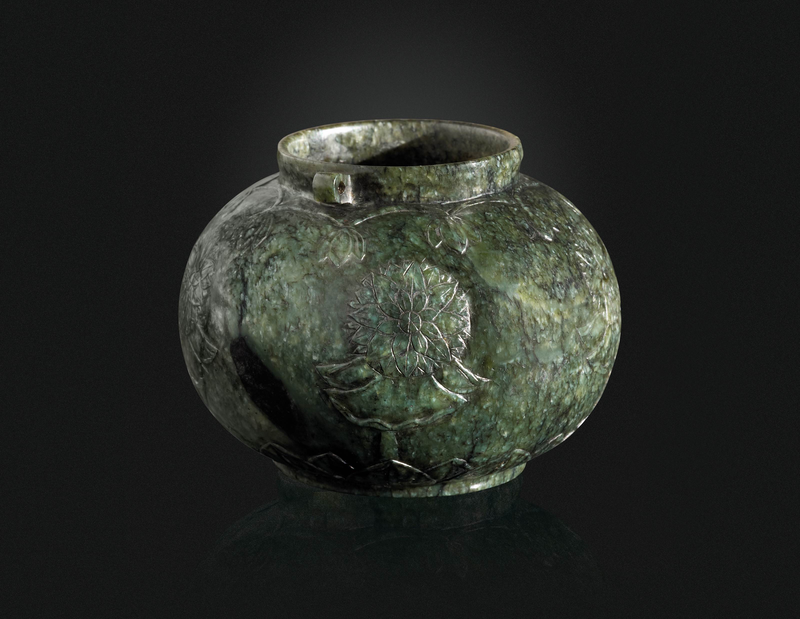 A CARVED JADE INKWELL