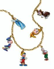 A WHIMSICAL ENAMEL AND GOLD 'P