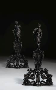 A PAIR OF BRONZE ANDIRONS WITH