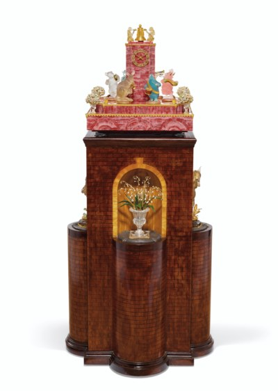 A GOLD, GEM, AND HARDSTONE-MOUNTED RHODOCHROSITE MUSICAL CLOCK ON...