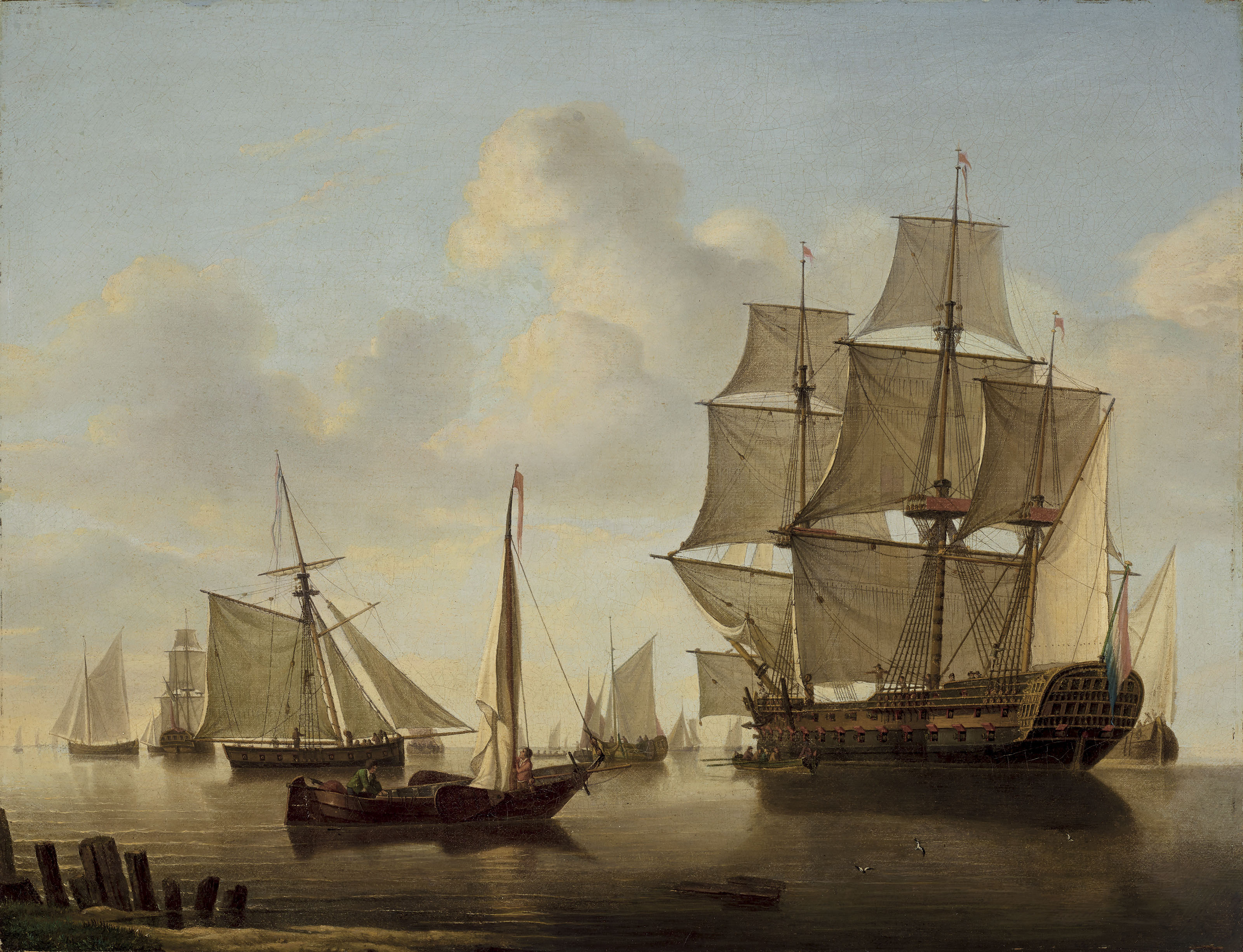 A Dutch two-decker and other ships in a calm sea