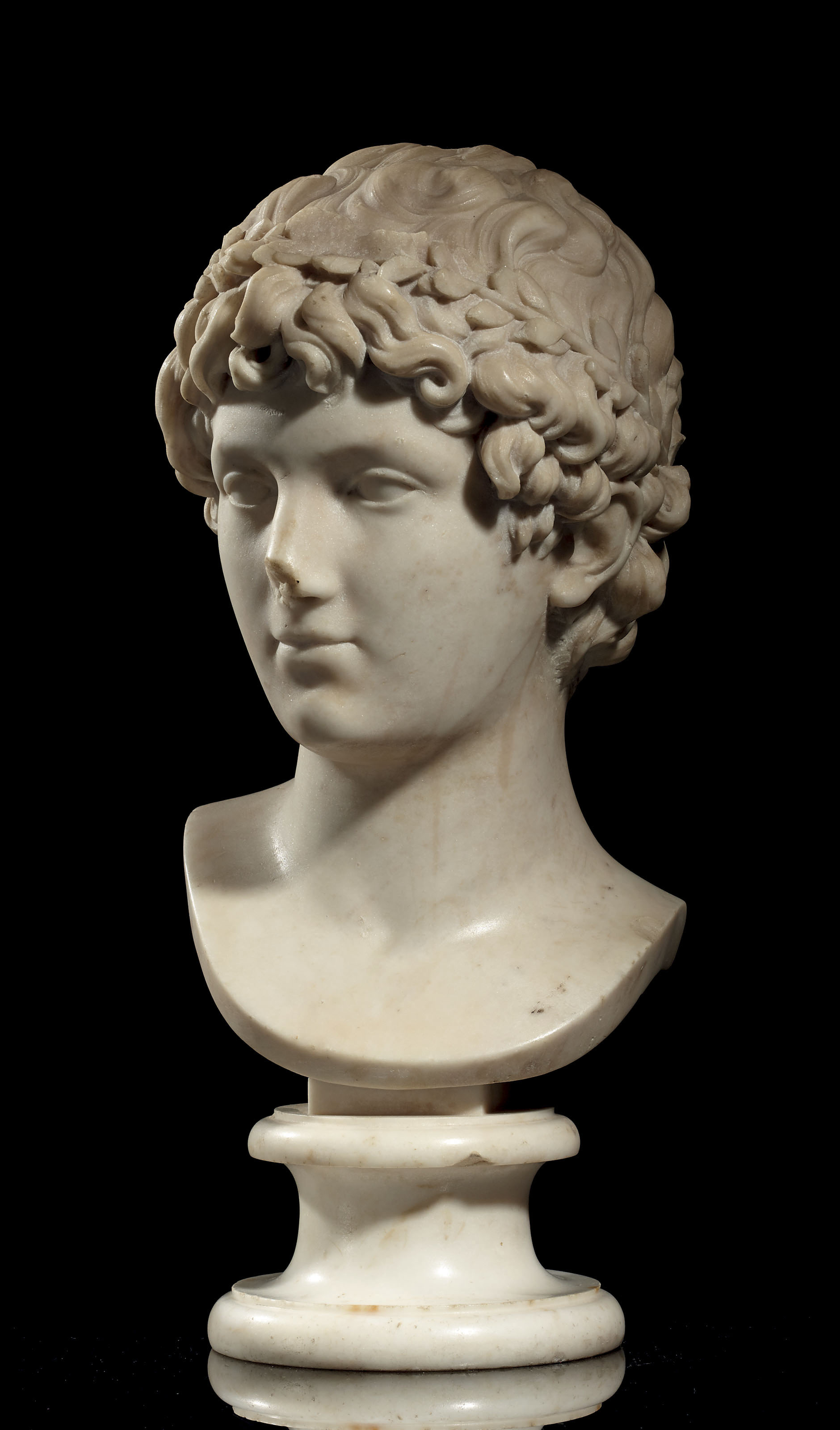 A MARBLE BUST OF A ROMAN YOUTH