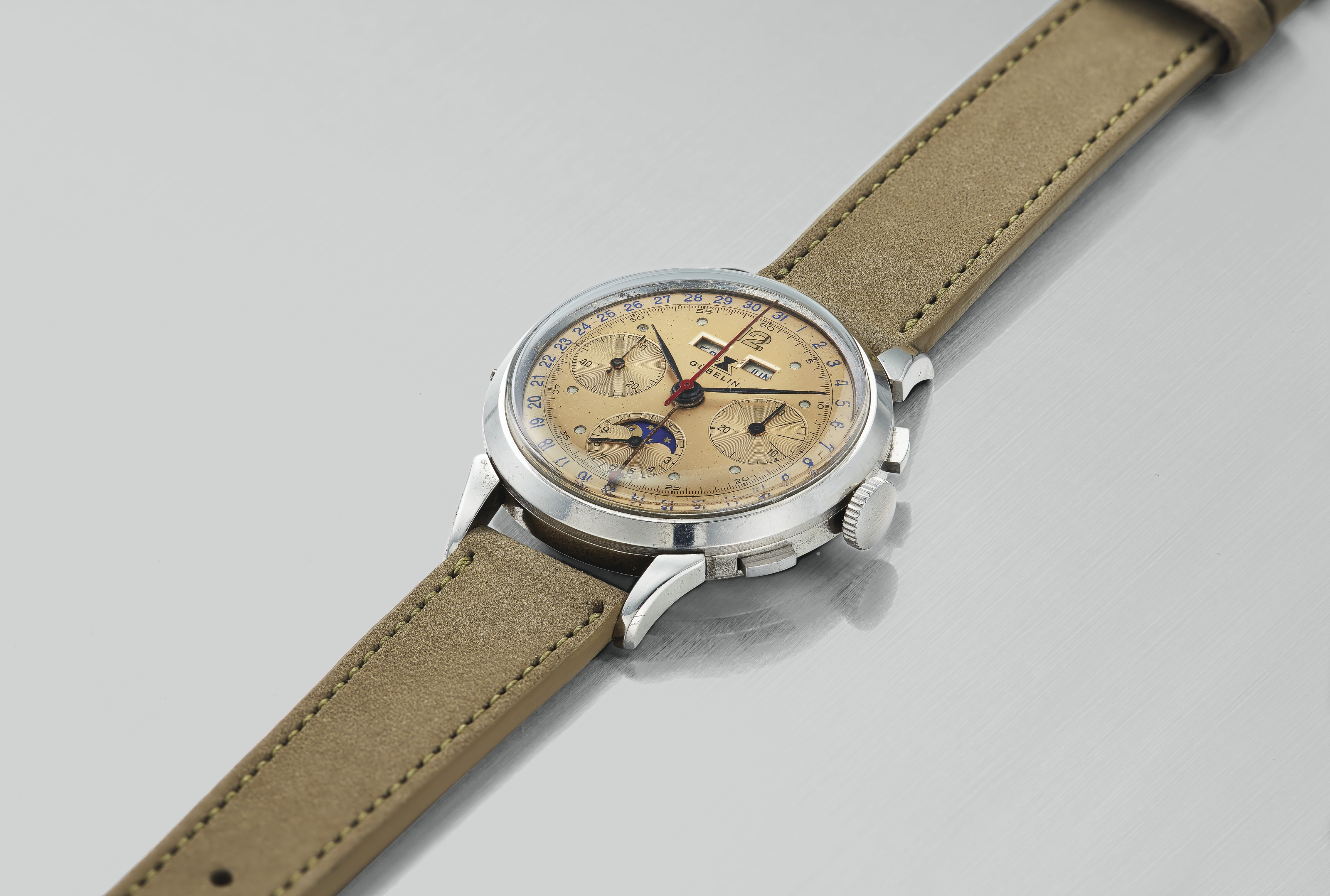 Gubelin. A Very Fine and Rare Triple Calendar Chronograph Wristwatch with Moonphases