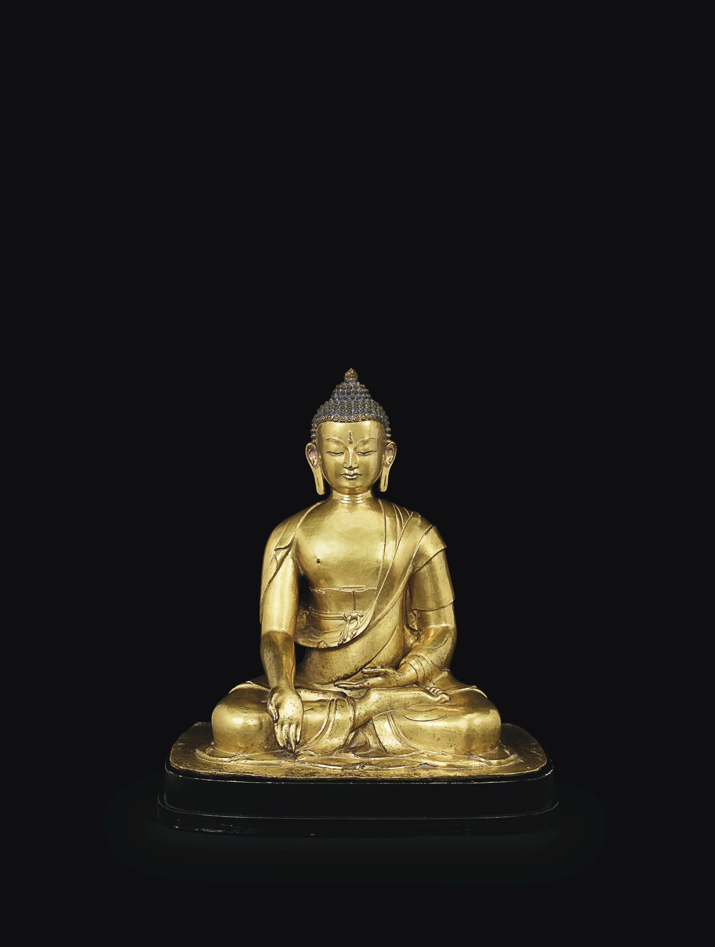 A RARE GILT-BRONZE FIGURE OF BUDDHA RATNASAMBHAVA