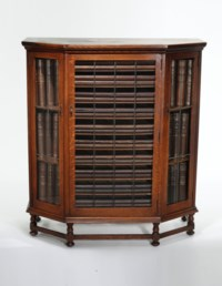 AN AMERICAN OAK BOOK CABINET FROM THE PERSONAL LIBRARY OF EDWARD S. CURTIS, BUILT TO HOLD THE VOLUMES AND SUPPLEMENTAL FOLIOS OF THE NORTH AMERICAN INDIAN
