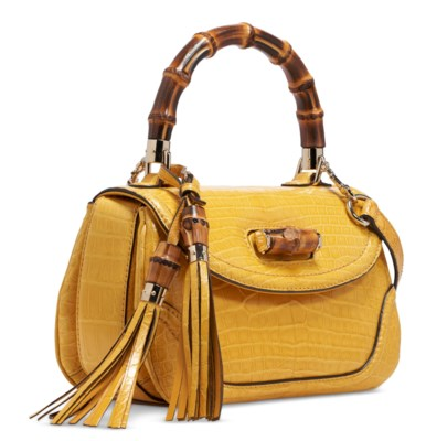 A YELLOW CROCODILE NEW BAMBOO SMALL TOP HANDLE BAG WITH GOLD HARDWARE