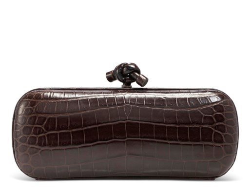 A MATTE BROWN CROCODILE KNOT CLUTCH WITH SILVER HARDWARE
