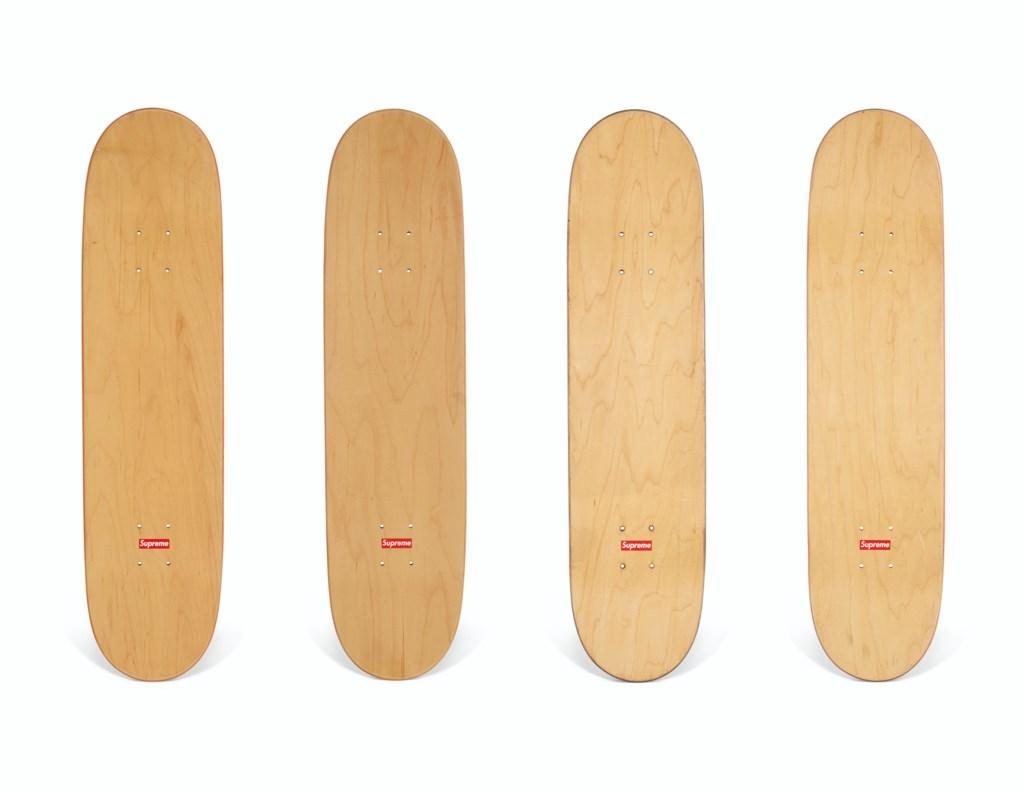 A SET OF FOUR MOTION LOGO SKATEBOARDS