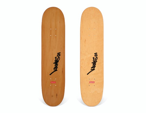 A SET OF TWO SIGNED KAWS CHUM SKATEBOARDS