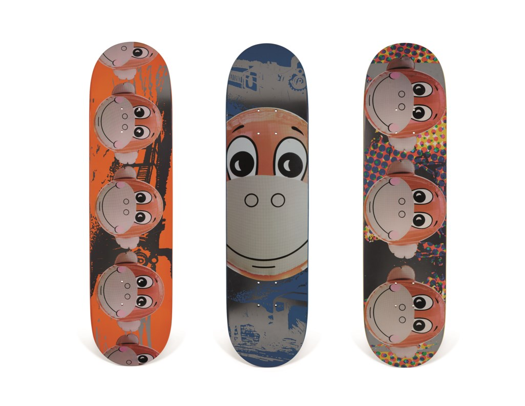 A SET OF THREE JEFF KOONS MONKEY TRAIN SKATEBOARDS