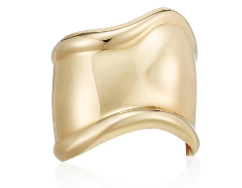 Tiffany & Co. Elsa Peretti gold bone cuff bracelet. 15.5 cm continuous inner circumference with 2.8 cm opening, 5.5 cm widest point. Sold for $6,875 on 13 December 2019 at Christie's
