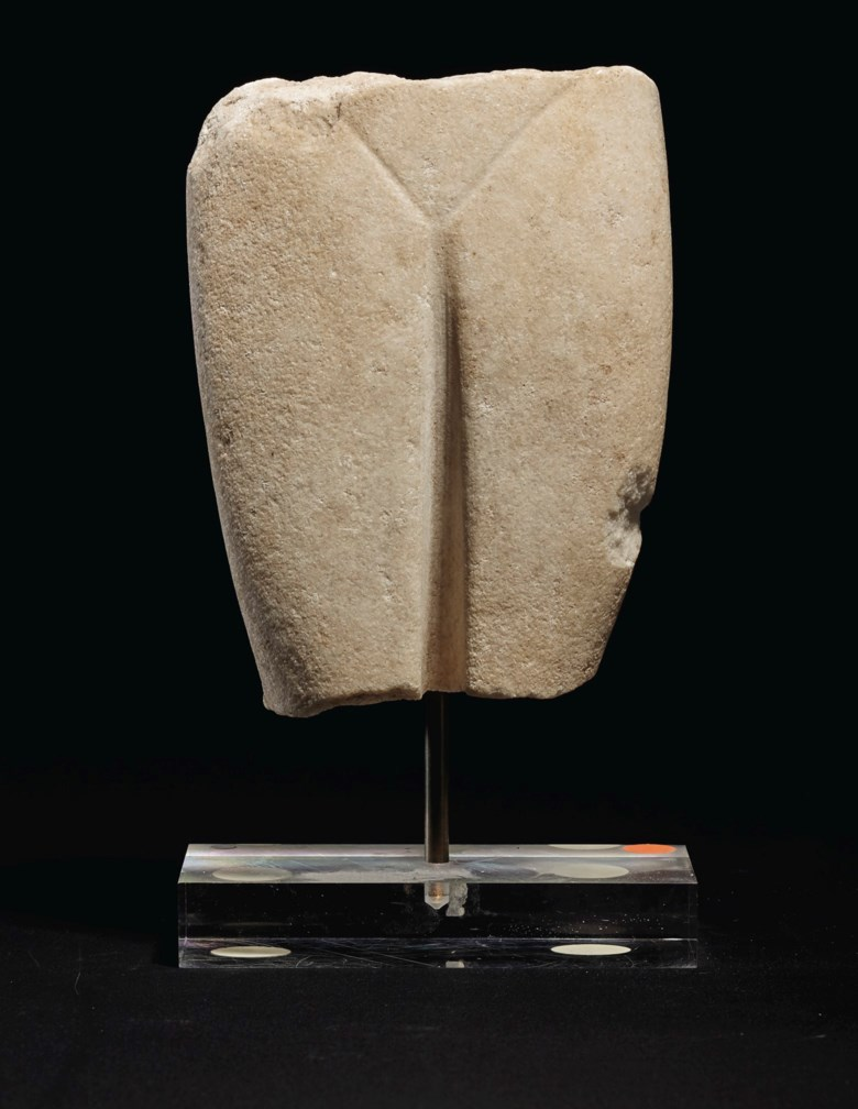 A marble fragmentary female figure, Late Spedos variety, early Cycladic II circa 2500-2400 B.C.. 5¾ in (14.6 cm) high. Estimate $4,000-6,000. Offered in Antiquities on 28 October 2019 at Christie's in New York