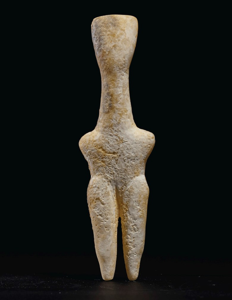 A Cycladic marble female figure, Louros variety, early Cycladic I-II circa 2800-2700 B.C.. 5 316  in (13.1  cm) high. Estimate $12,000-18,000. Offered in Antiquities on 28 October 2019 at Christie's in New York