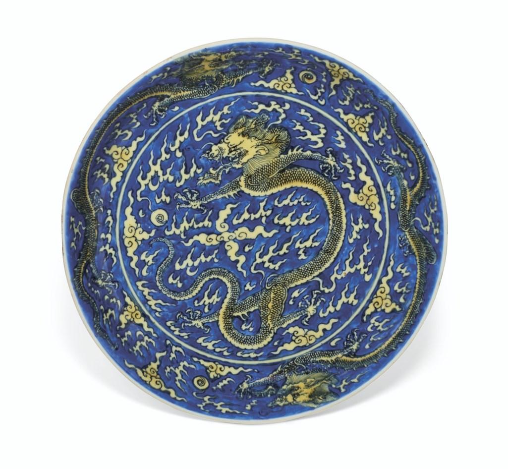 A YELLOW-ENAMELED BLUE-GROUND 'DRAGON' DISH