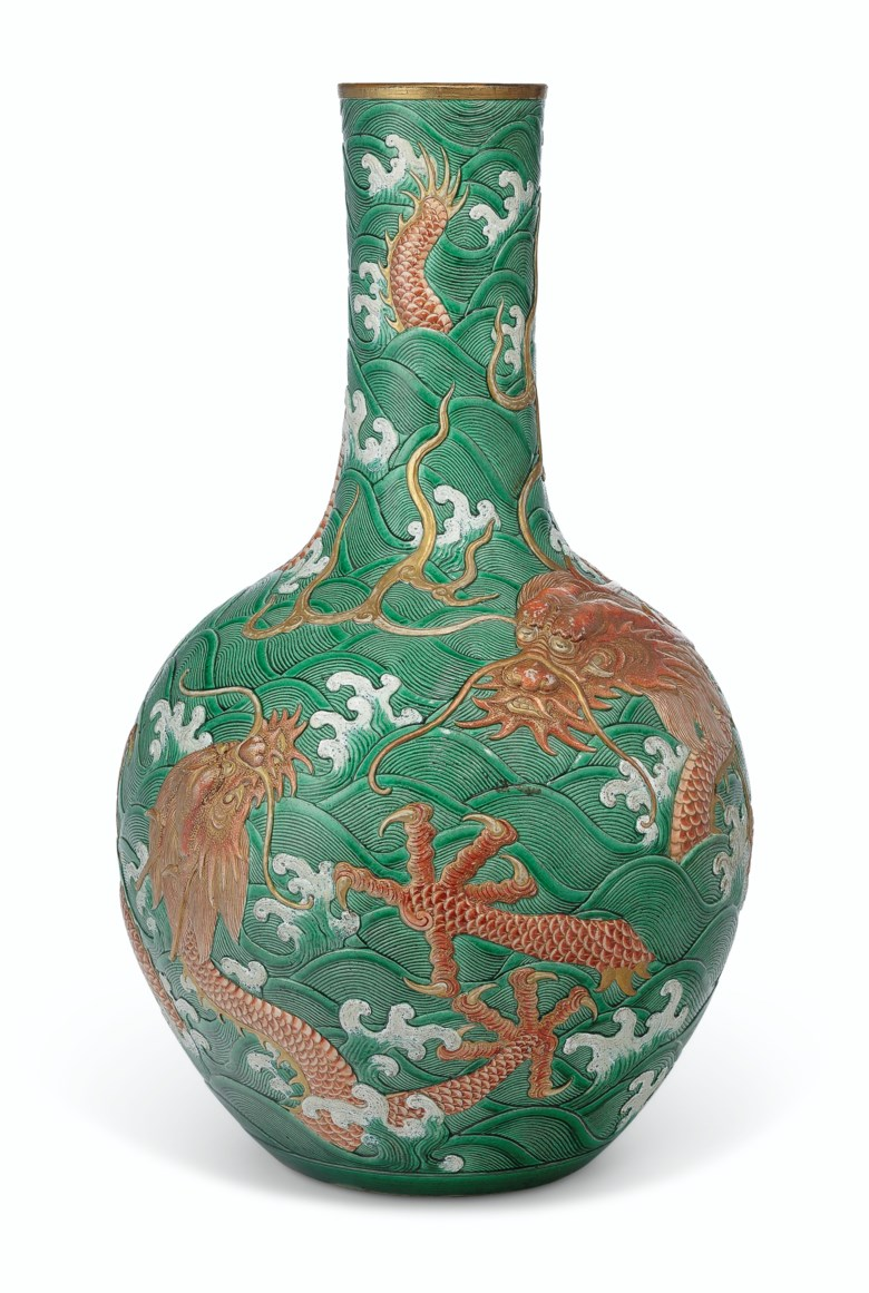 A rare and unusual large green-glazed and iron-red-decorated moulded 'dragon' vase, 18th-19th century. 23½  in (59.7  cm) high. Sold for $337,500 on 12 September 2019 at Christie's in New York