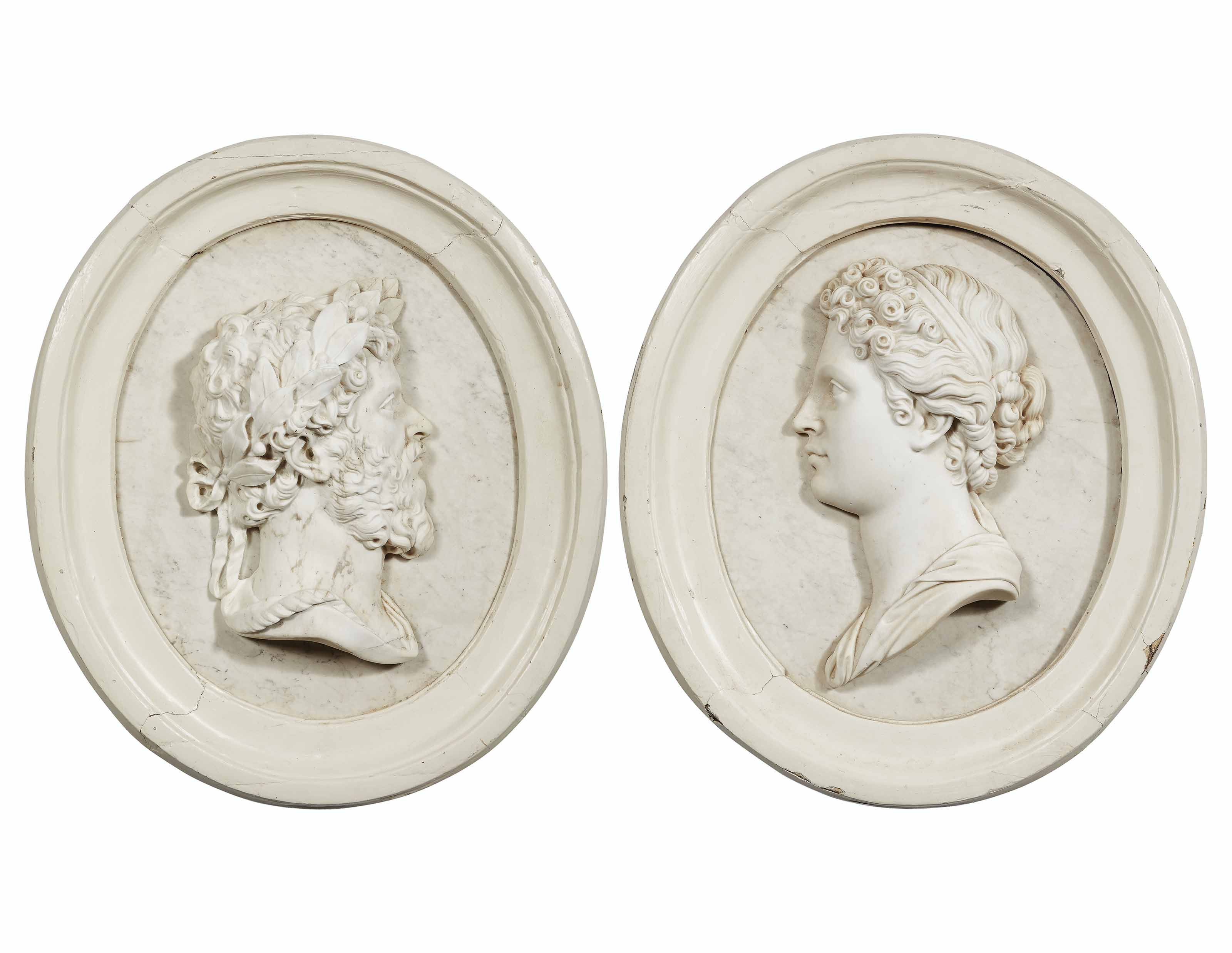A PAIR OF WHITE MARBLE RELIEFS OF A ROMAN EMPEROR AND EMPRESS
