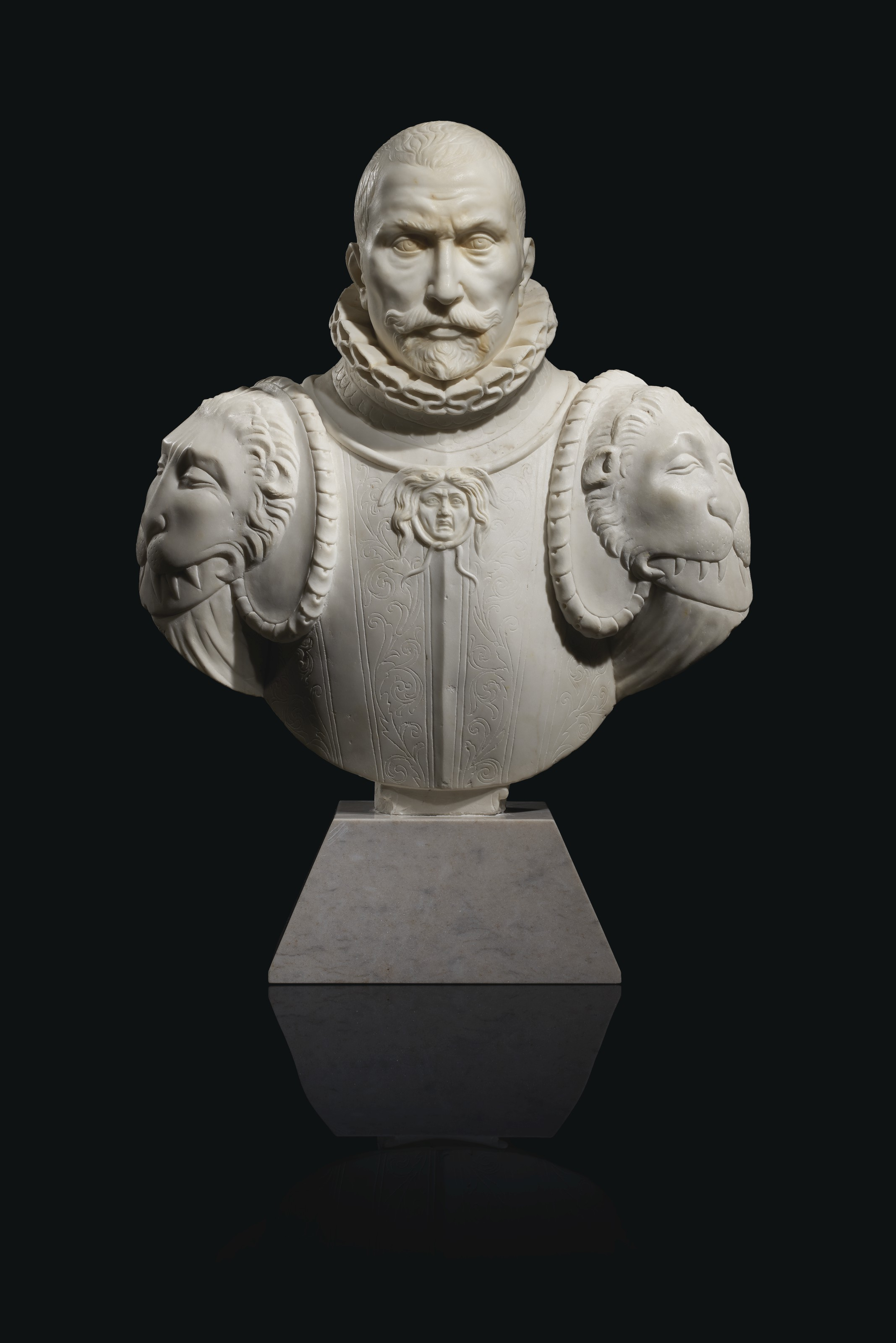 A WHITE MARBLE BUST OF A GENTLEMAN IN ARMOR