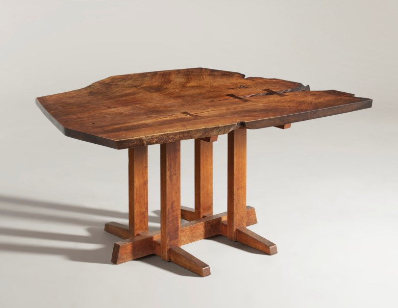 George Nakashima (1905-1990), 'Frenchman's Cove' dining table, circa 1968. 28½ in (72 cm) high; 57 in (145 cm) wide; 50 in (127 cm) deep. Sold for $56,250 on 13 December 2019 at Christie's in New York