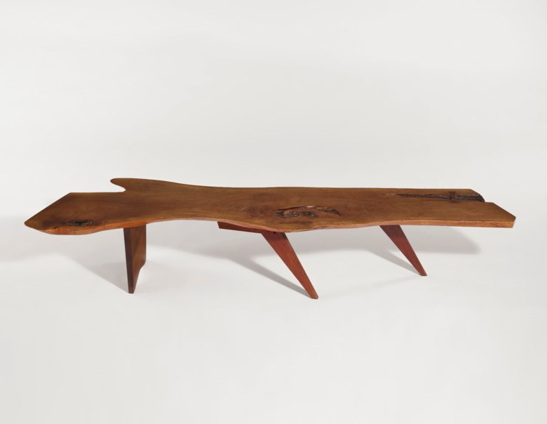 George Nakashima (1905-1990), 'Slab' coffee table, circa 1980. 13  in (33 cm) high; 71¾ in (182.2 cm) wide; 22½  in (57.2 cm) deep. Estimate $15,000-20,000. Offered in Design on 13 December 2019 at Christie's in New York