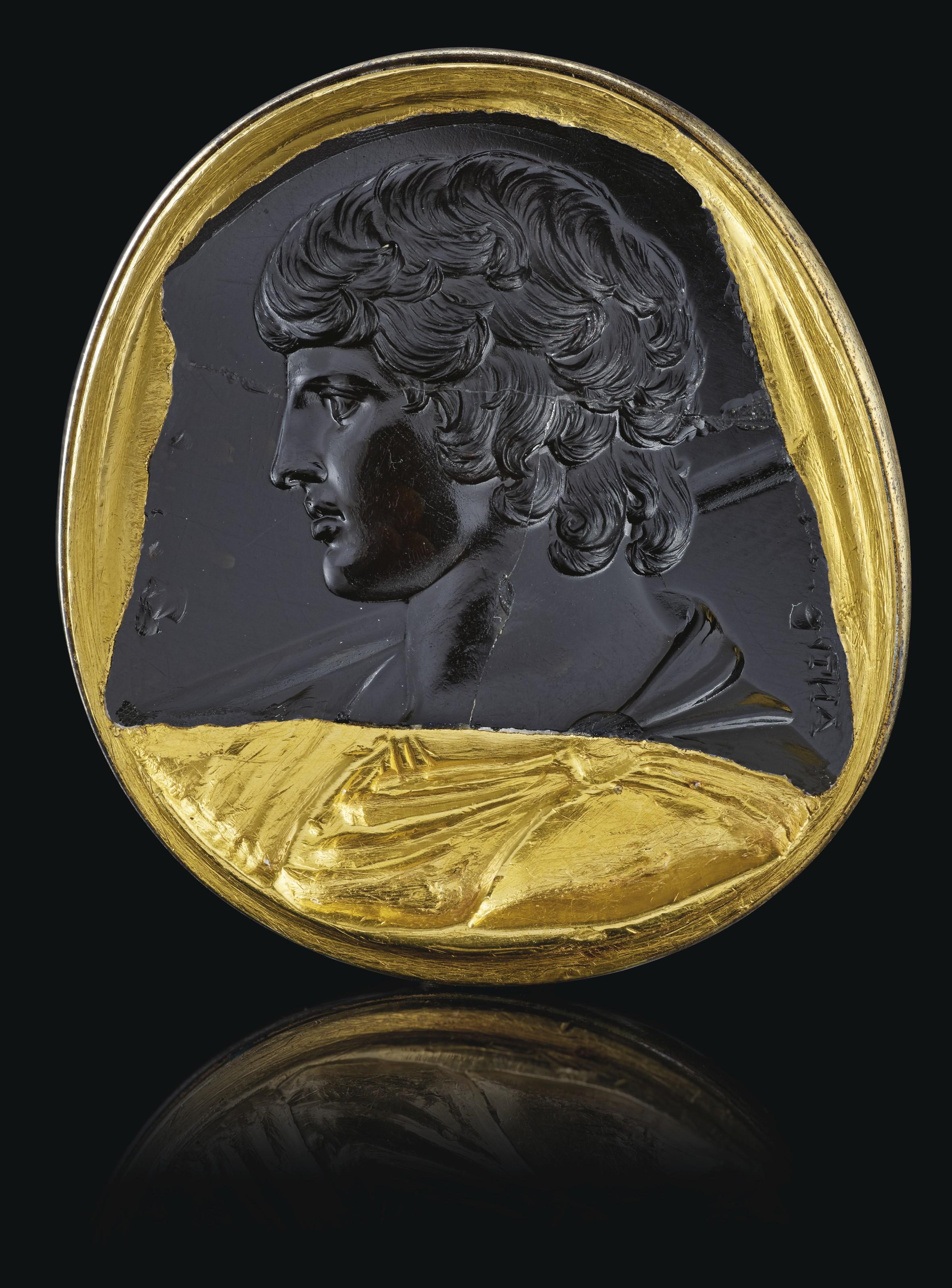 A ROMAN BLACK CHALCEDONY INTAGLIO PORTRAIT OF ANTINOUS