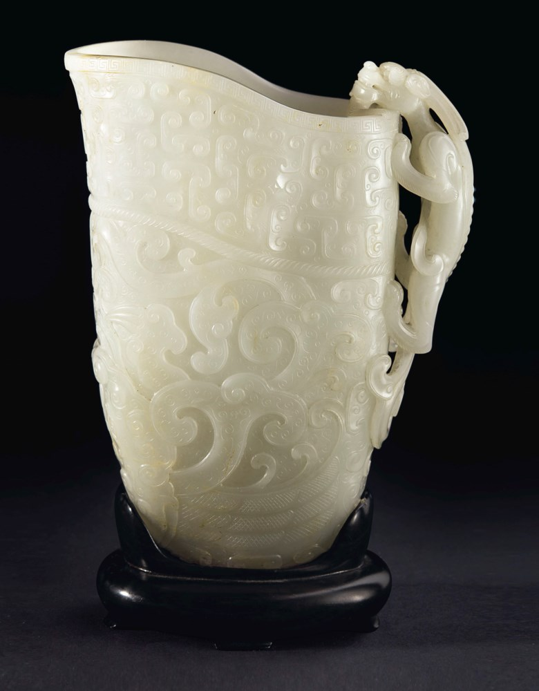A finely carved white jade archaistic rhyton, China, Qing Dynasty, 17th-18th century. 7  in (17.8  cm) high. Sold for $639,000 on 20 March 2019 at Christie's in New York