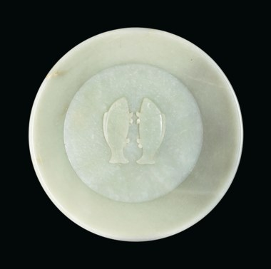 An important and extremely rare imperially inscribed greenish-white jade ''twin fish'' washer, China. Qing Dynasty, 1786. 10 in (25.4 cm) diam. Sold for $2,895,000 on 20 March 2019 at Christie's in New York