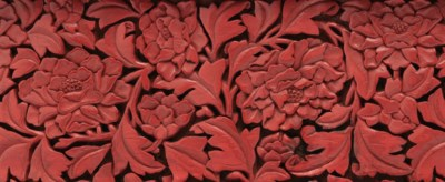 A RARE AND FINELY CARVED RED L