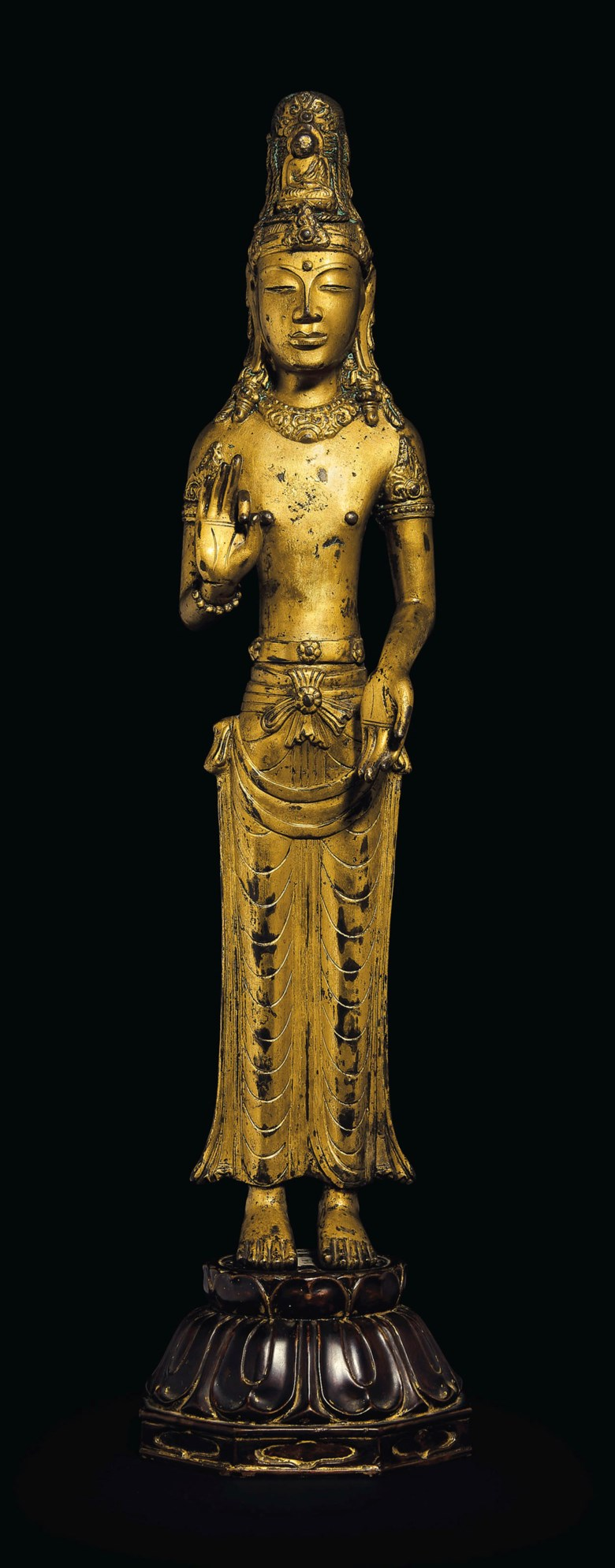 A rare gilt-bronze standing figure of an Acuoye Guanyin, China, Yunnan, Dali kingdom, 12th century. 18  in (45.7  cm) high. Estimate $2,000,000-3,000,000. Offered in Lacquer, Jade, Bronze, Ink The Irving Collection Evening Sale on 20 March 2019 at Christie's in New York