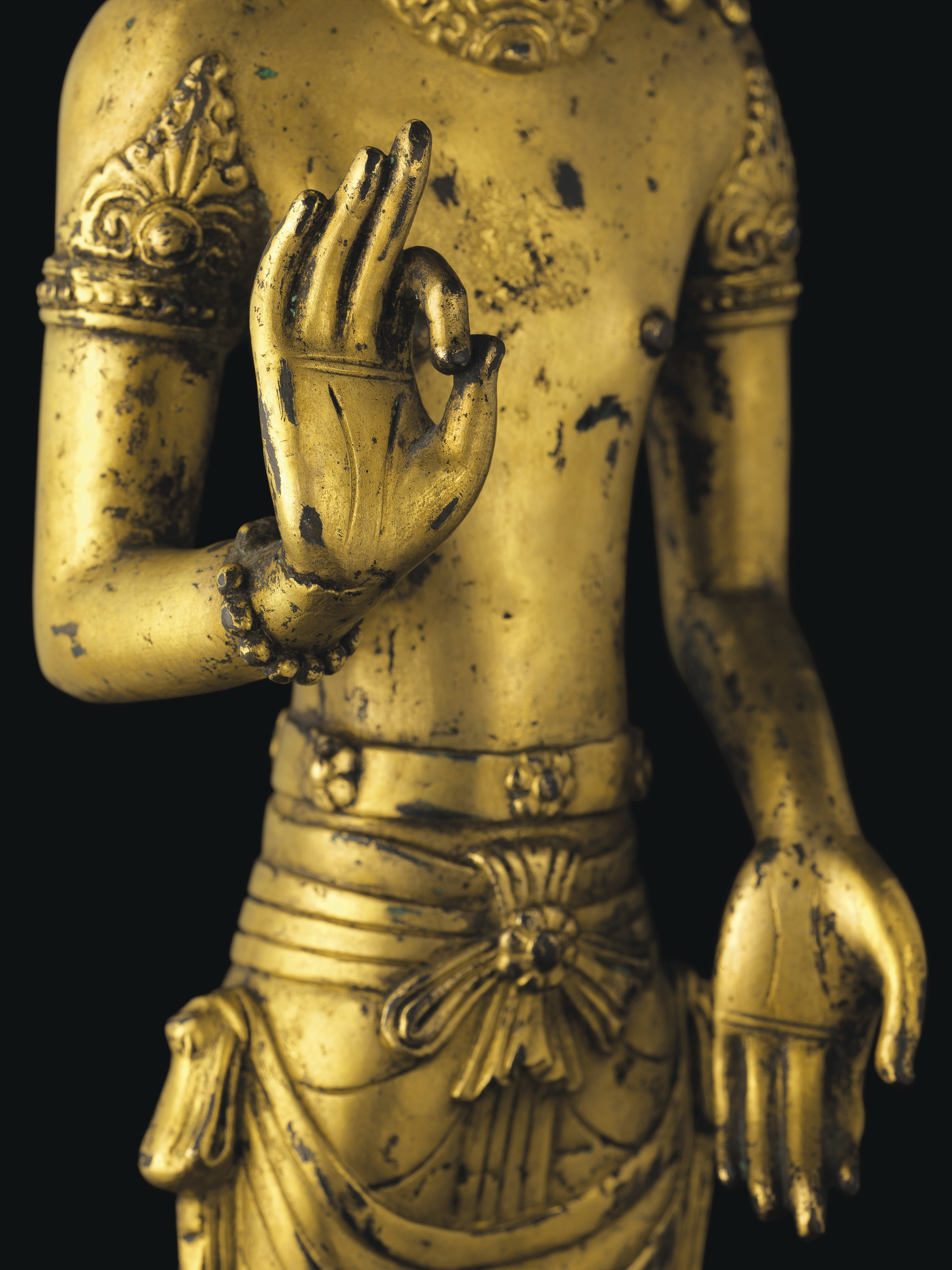 A RARE GILT-BRONZE STANDING FIGURE OF AN ACUOYE GUANYIN