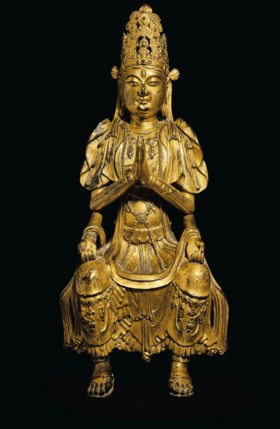 A HIGHLY IMPORTANT AND EXTREMELY RARE GILT-BRONZE FIGURE OF