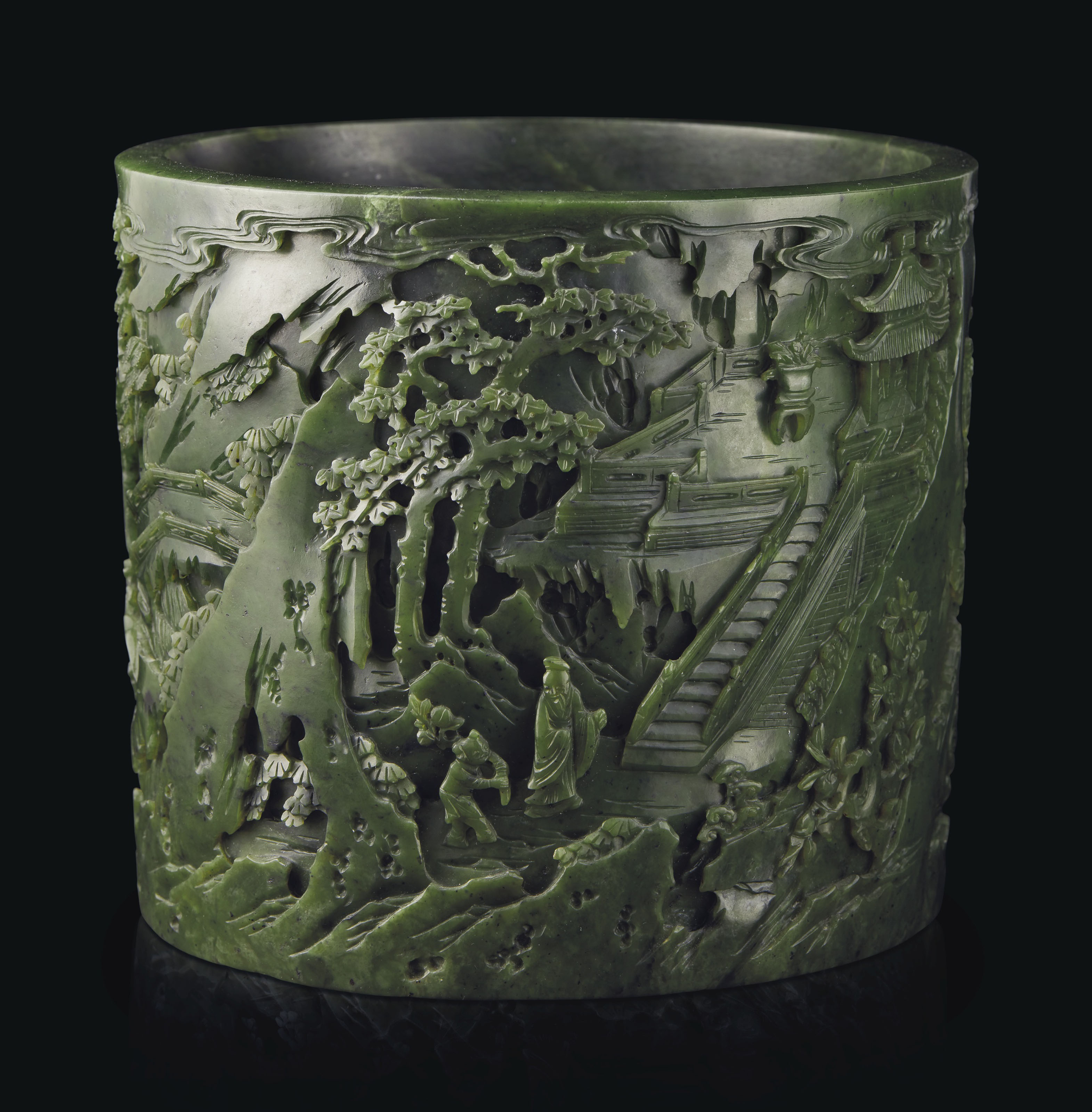 A FINELY CARVED SPINACH-GREEN JADE BRUSH POT
