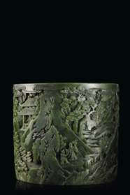A FINELY CARVED SPINACH-GREEN