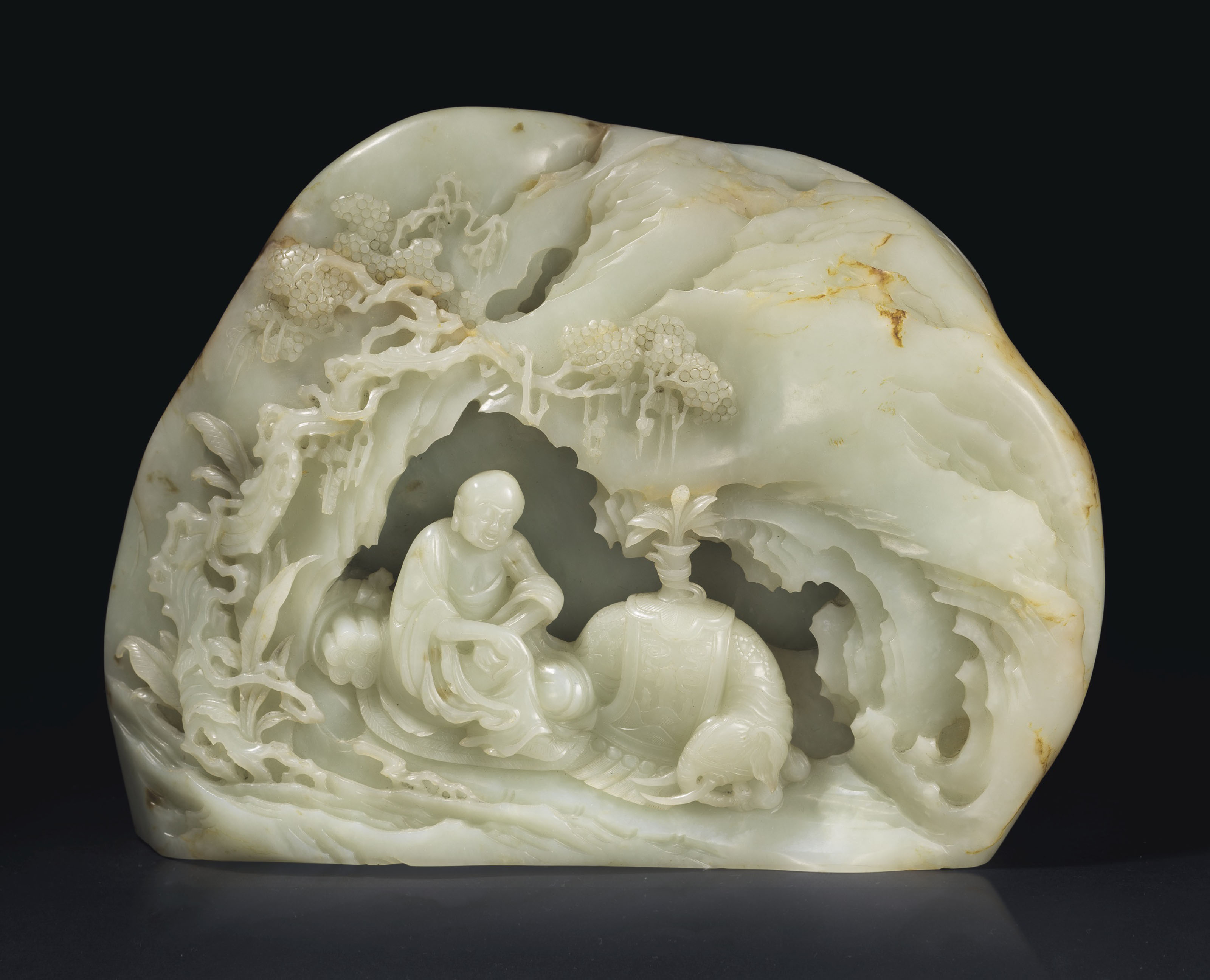 A LARGE AND FINELY CARVED WHITE JADE '' LUOHAN '' BOULDER