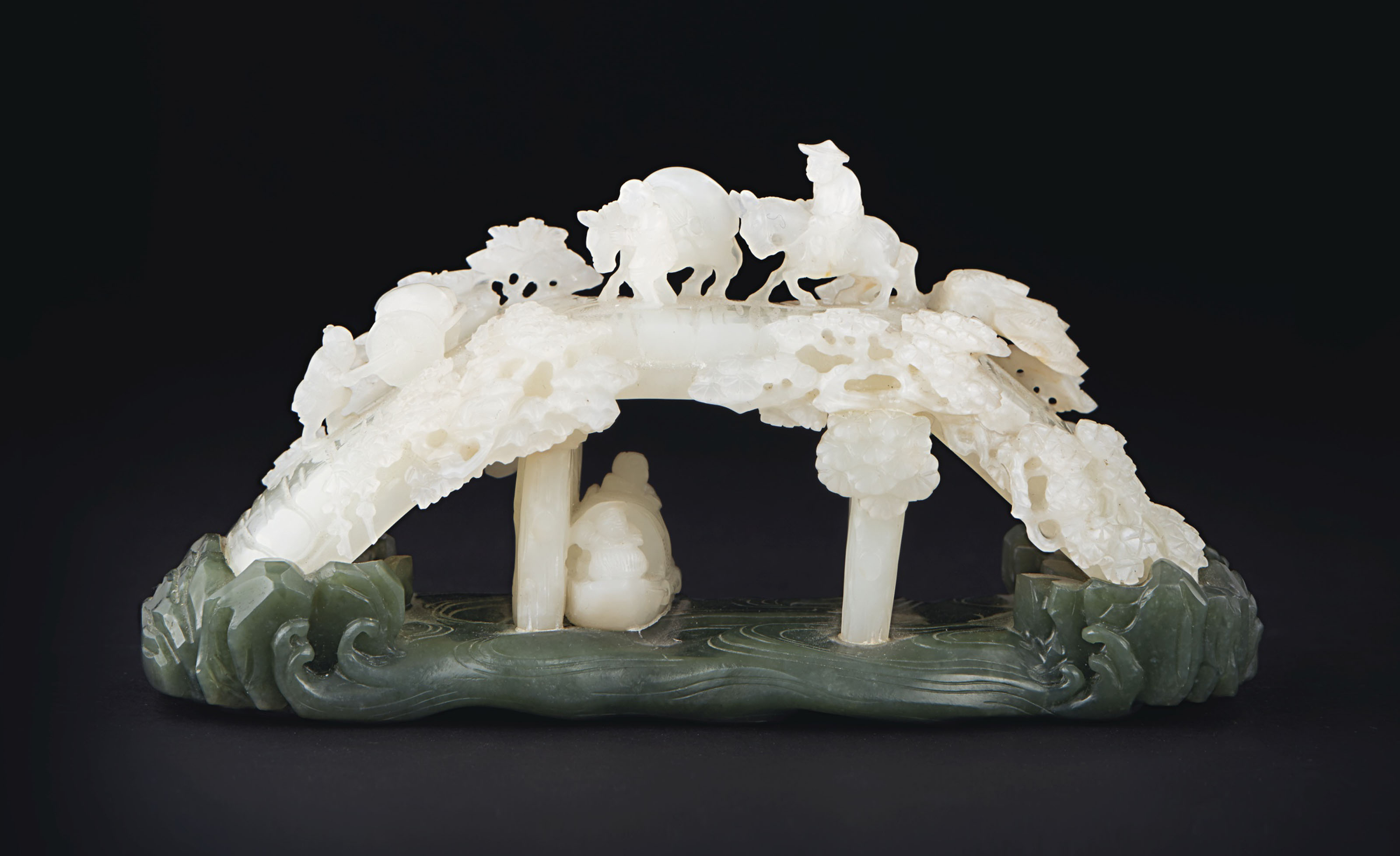 A RARE AND FINELY CARVED WHITE JADE ''BRIDGE SCENE'' BRUSH REST AND...