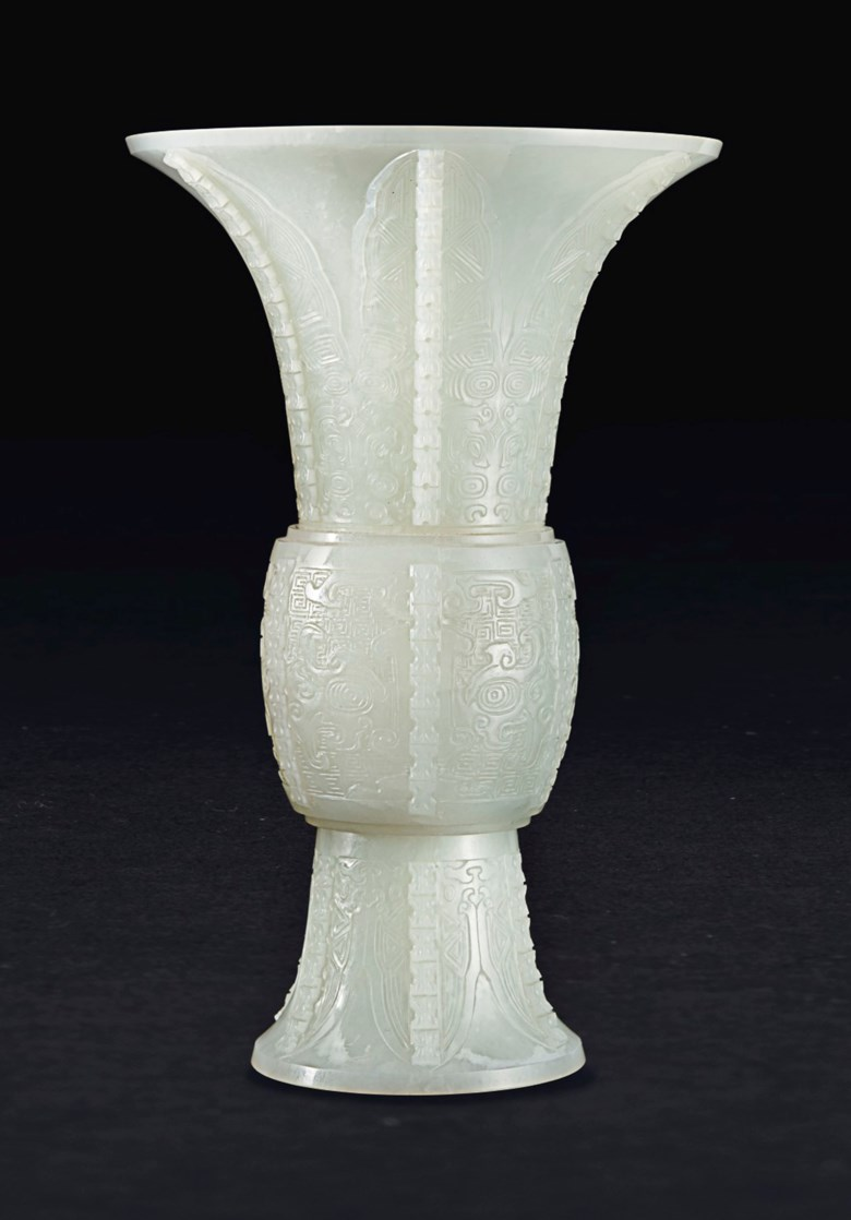 A white jade gu-form vase, China, Qing Dynasty, 19th century. 8⅝ in (21.9 cm) high. Sold for $118,750 on 21 March 2019 at Christie's in New York