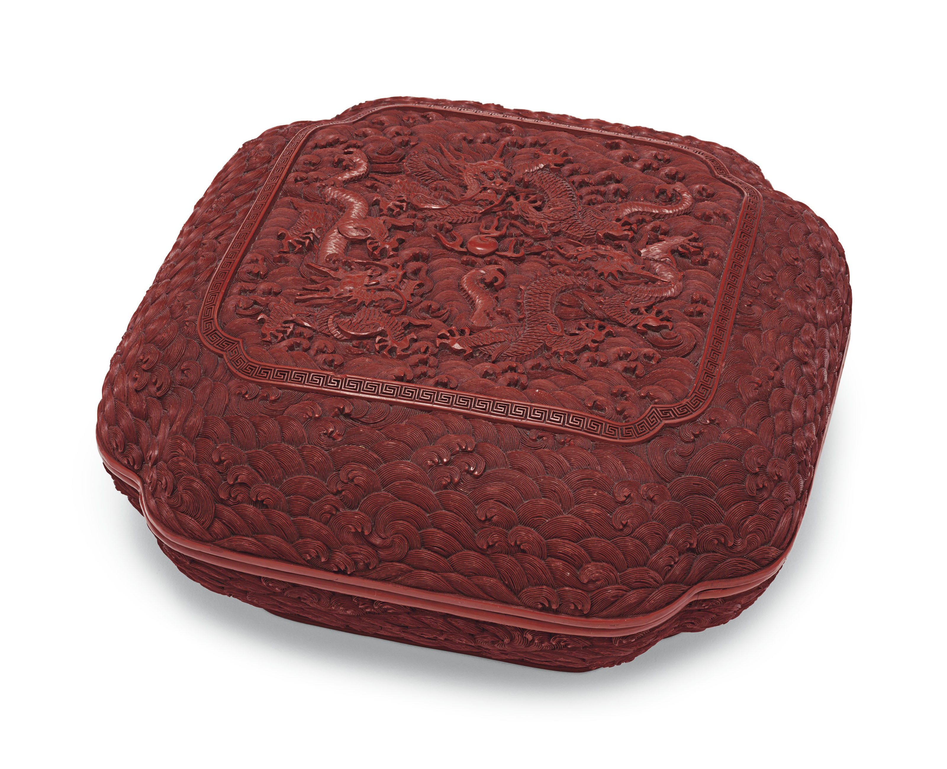 A CARVED RED LACQUER SQUARE ''DRAGON'' BOX AND COVER