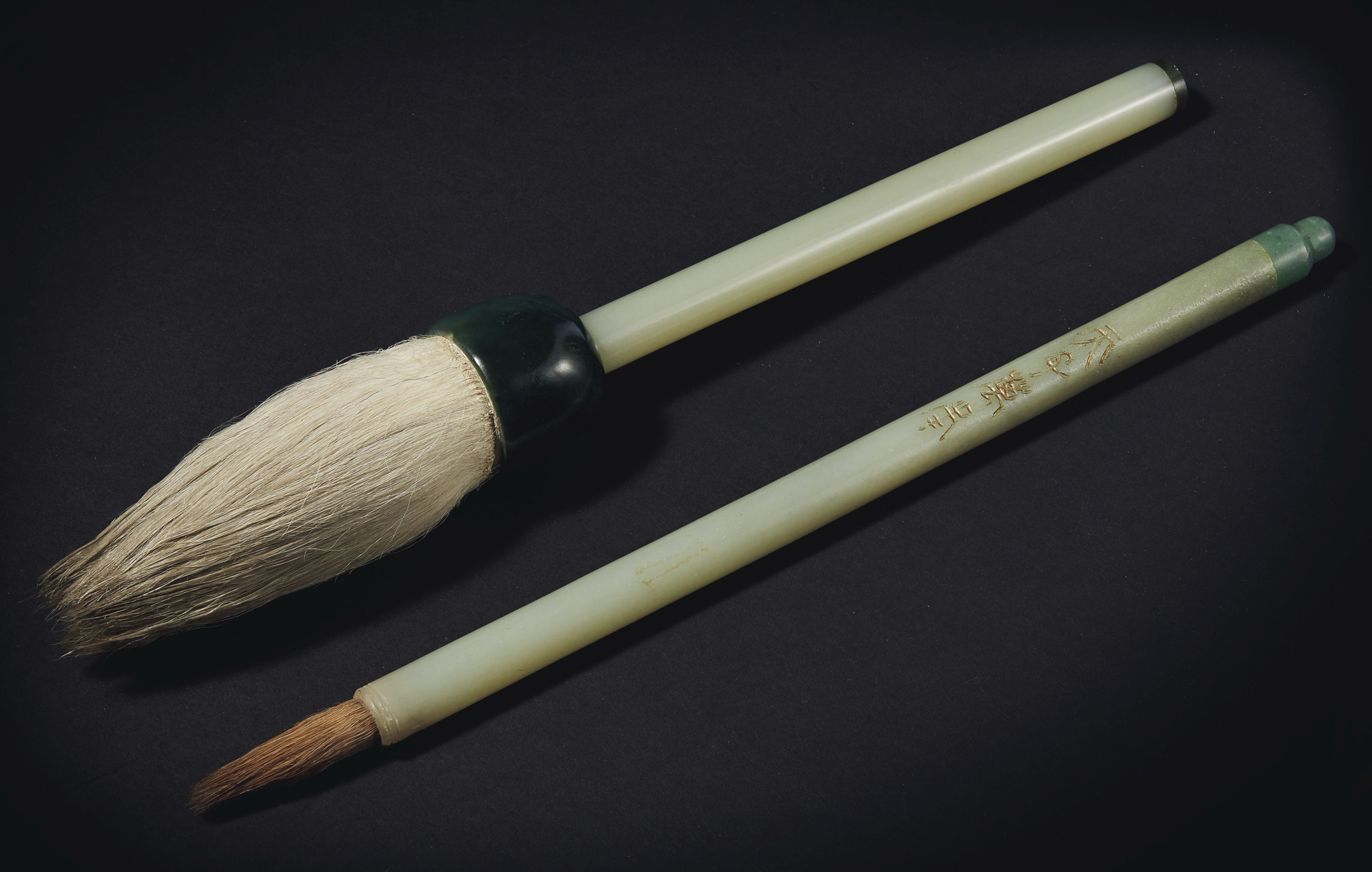 TWO PALE GREENISH-WHITE AND SPINACH-GREEN JADE BRUSHES
