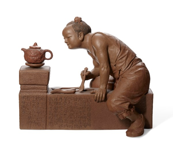 A YIXING MODEL OF A POTTER, 'GONG CHUN AT WORK'