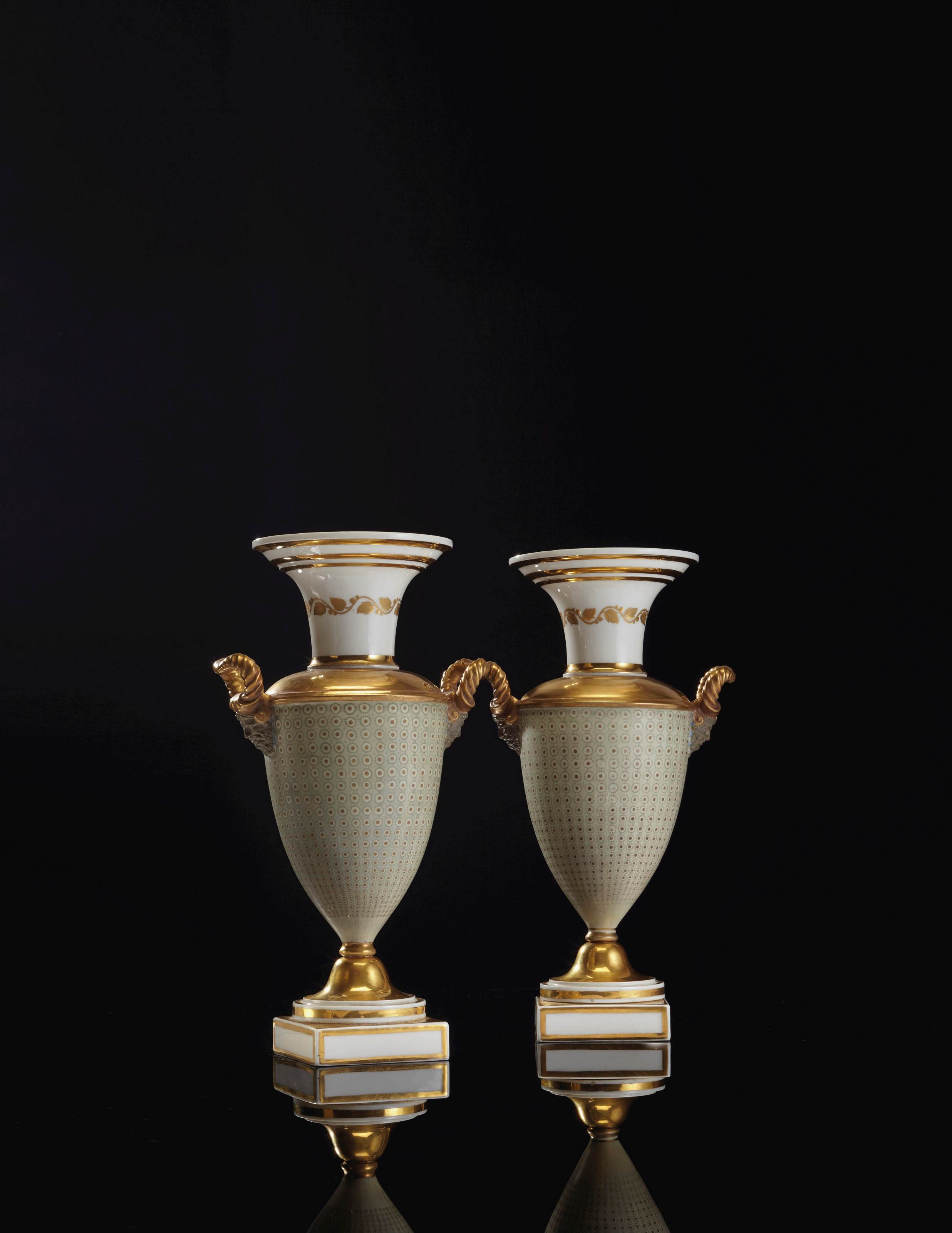 A PAIR OF PARIS GOLD AND CELADON GROUND PORCELAIN VASES