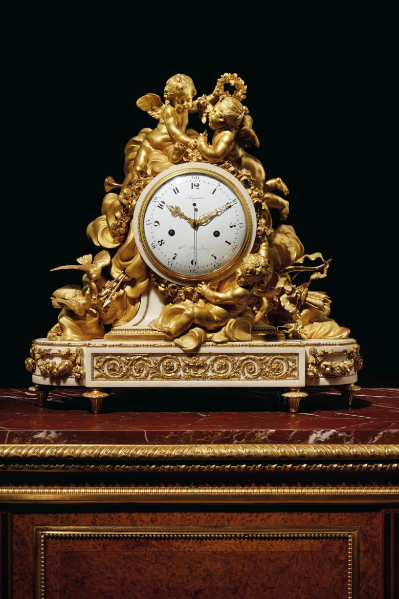 A monumental Louis XVI ormolu and white marble mantel clock, 1775. 26  in (66  cm) high, 26½  in (67.3  cm) wide, 8¼  in (21  cm) deep. Estimate $60,000-100,000. This Offered in Fifth Avenue Grandeur Important French Furniture from the Collection of Lewis and Ali Sanders on 29 October 2019 at Christie's in New York