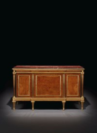 A LOUIS XVI ORMOLU-MOUNTED BURR-YEW AND MAHOGANY COMMODE À VANTAUX