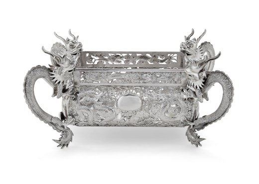 A CHINESE EXPORT SILVER FOUR-HANDLED BASKET