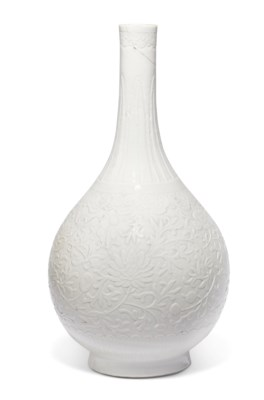 A MOLDED WHITE-GLAZED SOFT-PASTE BOTTLE VASE