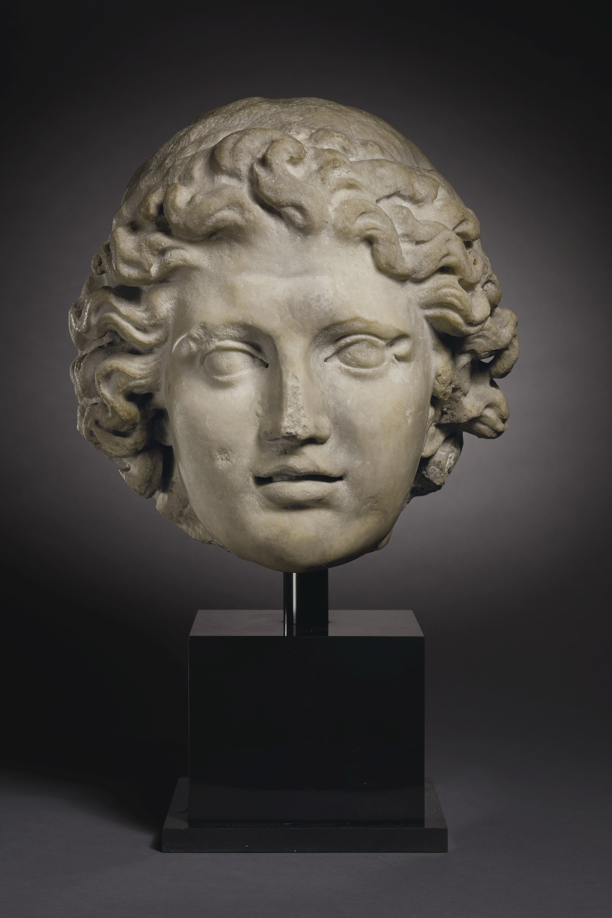 A MONUMENTAL ROMAN MARBLE PORTRAIT HEAD OF ALEXANDER THE GREAT
