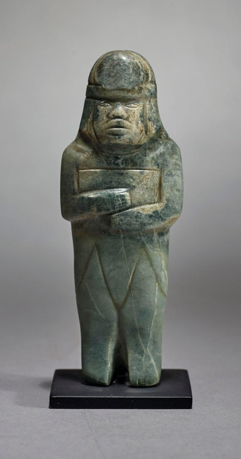 Olmec jade figure, Pre-Classic, circa 900-600 BC.Height 12.4 cm. Sold for €27,500on 9 April 2019 at Christie's in Paris