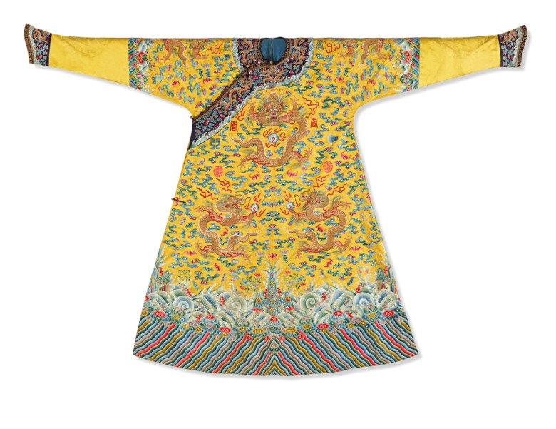 A magnificent imperial yellow embroidered satin 'Twelve Symbol' dragon robe, Longpaochina Qing Dynasty. Sold for €586,000 on 12 June 2019 at Christies in Paris