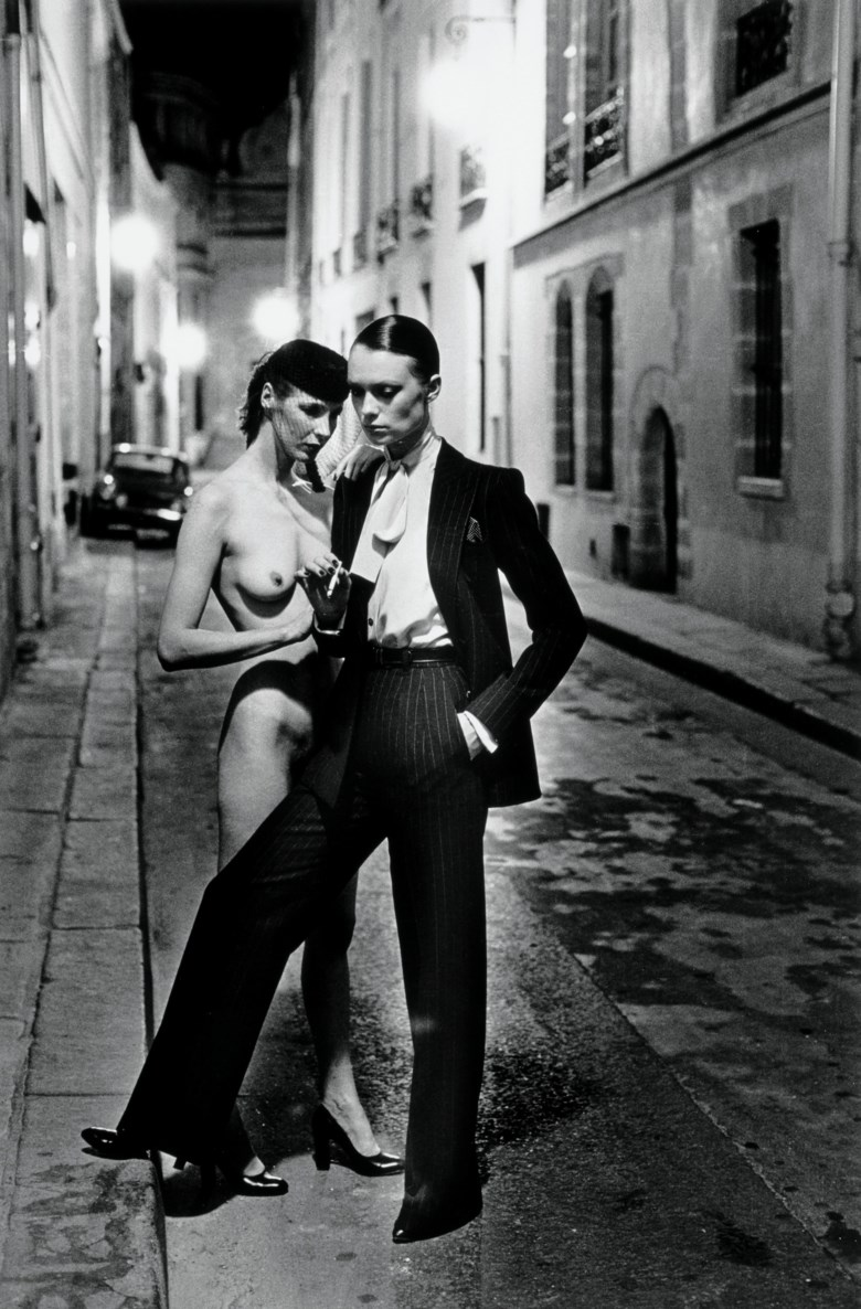 Helmut Newton (1920-2004), Aubriot Street, (YSL + Nude), Paris, 1975. Sheet 60.8 x 50.5  cm (24 x 19⅞  in). Estimate €30,000-40,000. Offered in Icons of Glamour & Style The Constantiner Collection on June 19 2019 at Christie's in Paris