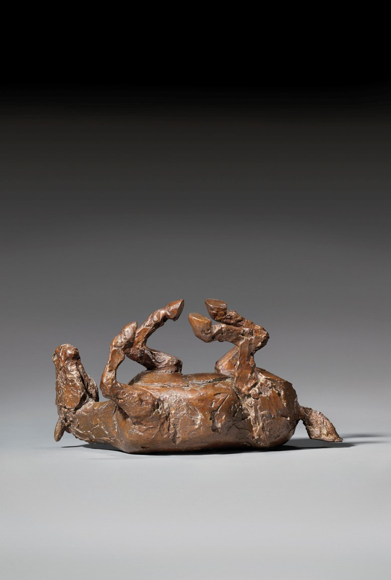 Dame Elisabeth Frink, R.A. (1930-1993), Rolling Horse, conceived in 1985. Bronze with a dark brown patina. 16½  in (41.9  cm) long. Estimate £40,000-60,000. Offered in Modern British Art Day Sale on 22 January 2020 at Christie's in London